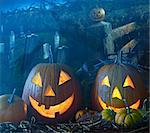 Brightly lit Halloween pumpkins in the grave yard Stock Photo - Royalty-Free, Artist: Sandralise                    , Code: 400-05683274