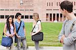 Student looking at his classmates talking outside a building Stock Photo - Royalty-Free, Artist: 4774344sean                   , Code: 400-05684092