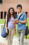 Portrait of a couple holding a tablet computer outside a building Stock Photo - Royalty-Free, Artist: 4774344sean                   , Code: 400-05684098