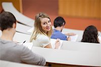 Young student being distracted in an amphitheater Stock Photo - Royalty-Freenull, Code: 400-05684364