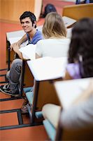 Portrait of a handsome student being distracted in an amphitheater Stock Photo - Royalty-Freenull, Code: 400-05684380