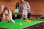 Friends playing snooker in a student home