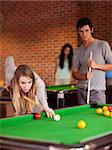 Portrait of friends playing snooker in a student home