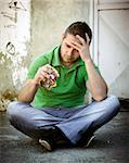 Depressed young man sitting on concrete Stock Photo - Royalty-Free, Artist: silent47                      , Code: 400-05686222