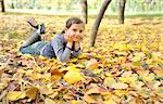 girl lying on fall leaves outdoors Stock Photo - Royalty-Free, Artist: jordache                      , Code: 400-05686433
