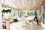 Woman Walking Through Conservatory Stock Photo - Royalty-Free, Artist: MonkeyBusinessImages          , Code: 400-05686458