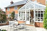 Exterior Of House With Conservatory And Patio Stock Photo - Royalty-Free, Artist: MonkeyBusinessImages          , Code: 400-05686462