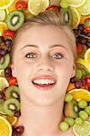 Portrait Of Young Woman Surrounded By Fruit