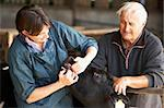 Farmer With Vet Examining Calf Stock Photo - Royalty-Free, Artist: MonkeyBusinessImages          , Code: 400-05686822