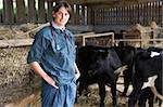 Portrait Of Vet In Barn With Cattle Stock Photo - Royalty-Free, Artist: MonkeyBusinessImages          , Code: 400-05686824