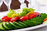 Cucumber and tomato salad in plate Stock Photo - Royalty-Free, Artist: ElnurCrestock                 , Code: 400-05687765