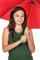 Pretty teen girl with a red umbrella isolated over white background Stock Photo - Royalty-Freenull, Code: 400-05689383
