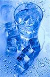 Ice can refer any of the 14 known solid phases of water. However, in non-scientific contexts, it usually describes ice Ih, which is the most abundant of these phases in Earth's biosphere. This type of ice is a soft, fragile, crystalline solid, which can appear transparent or an opaque bluish-white color depending on the presence of impurities such as air. The manufacture and use of ice cubes or cr Stock Photo - Royalty-Free, Artist: JanPietruszka                 , Code: 400-05692288