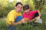 Sibling Girls Hunting for Insects While Camping Outdoors Stock Photo - Royalty-Free, Artist: tobkatina                     , Code: 400-05693323