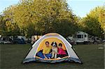 Sibling Girls and Dog in a Tent While Camping Outdoors Stock Photo - Royalty-Free, Artist: tobkatina                     , Code: 400-05693345
