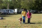 Sibling Girls Walking a Dog While Camping Outdoors Stock Photo - Royalty-Free, Artist: tobkatina                     , Code: 400-05693348