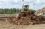 A dozer moving earth to level a pile of earth Stock Photo - Royalty-Free, Artist: EdCorey                       , Code: 400-05693565