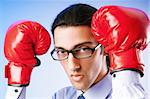Businessman with boxing gloves Stock Photo - Royalty-Free, Artist: ElnurCrestock                 , Code: 400-05695416