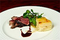 Image of a gourmet steak and potato dish Stock Photo - Royalty-Freenull, Code: 400-05697291
