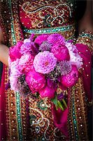 Image of an Indian brides hands holding bouquet Stock Photo - Royalty-Freenull, Code: 400-05697301