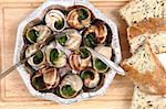 snails as french gourmet food with white bread Stock Photo - Royalty-Free, Artist: jonnysek                      , Code: 400-05699497