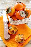 persimmon fruit on wooden table Stock Photo - Royalty-Free, Artist: Dream79                       , Code: 400-05701584