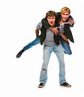 Cheerful modern man piggy backing his friend. Isolated on white  Stock Photo - Royalty-Freenull, Code: 400-05703097