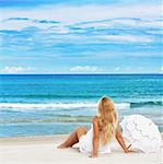 Woman with umbrella on the tropical beach Stock Photo - Royalty-Free, Artist: GoodOlga                      , Code: 400-05703158