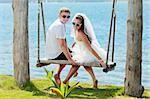 Bride and groom on the tropical beach Stock Photo - Royalty-Free, Artist: GoodOlga                      , Code: 400-05703161