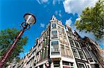 low angle view of some typical amsterdam houses and a lamppost Stock Photo - Royalty-Free, Artist: hansenn                       , Code: 400-05704477