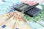 Profit concept. Closeup of fountain pen and calculator on european currency background Stock Photo - Royalty-Free, Artist: kvkirillov                    , Code: 400-05704847