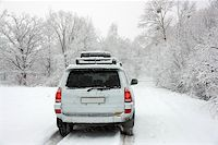 Snowy winter road behind an unrecognizable car Stock Photo - Royalty-Freenull, Code: 400-05704849