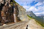 Waterfall flows down from the mountains onto the Going To The Sun Road in Glacier National Park - Montana. Stock Photo - Royalty-Free, Artist: Wirepec                       , Code: 400-05705147