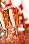 Two champagne flutes on Christmas background Stock Photo - Royalty-Free, Artist: pressmaster                   , Code: 400-05705288