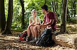 young man and woman having lunch with sandwich during hiking excursion. Horizontal shape, full length Stock Photo - Royalty-Free, Artist: diego_cervo                   , Code: 400-05705848