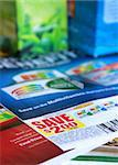 saving coupons with colorful product packages in the background Stock Photo - Royalty-Free, Artist: gksd777                       , Code: 400-05706075