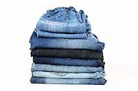 Stack of different jeans on white background Stock Photo - Royalty-Freenull, Code: 400-05708133