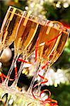 Several champagne flutes on Christmas background Stock Photo - Royalty-Free, Artist: pressmaster                   , Code: 400-05708186