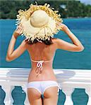 Girl on a tropical resort with hat