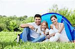 Family with a child in a tent on the nature Stock Photo - Royalty-Free, Artist: Deklofenak                    , Code: 400-05711781