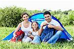 Happy family with a child in a tent on the nature Stock Photo - Royalty-Free, Artist: Deklofenak                    , Code: 400-05711787