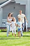 Running a family on the lawn Stock Photo - Royalty-Free, Artist: Deklofenak                    , Code: 400-05711847