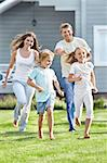Moving parents and children in the garden Stock Photo - Royalty-Free, Artist: Deklofenak                    , Code: 400-05711849