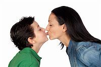 Adorable mother kissing her beautiful son isolated on white background Stock Photo - Royalty-Freenull, Code: 400-05712083