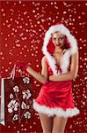 christmas glamour shot of a sexy blonde dresses as female santa claus with a short red dress and red gloves Stock Photo - Royalty-Free, Artist: carlodapino                   , Code: 400-05713405