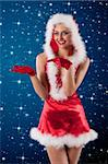 sexy shot of a female santa claus dressed with a red mini dress, hood and gloves smiling Stock Photo - Royalty-Free, Artist: carlodapino                   , Code: 400-05713407