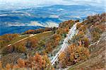 October Carpathian mountain plateau with first winter snow and autumn colorful foliage