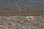 A pair of colorful beach slippers on the sand Stock Photo - Royalty-Free, Artist: alexandr6868                  , Code: 400-05713583