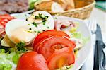 Fresh salad - Delicious fresh salad with tomatoes, lettuce, eggplant, zucchini, cheese, parma ham and olive oil. Stock Photo - Royalty-Free, Artist: ilolab                        , Code: 400-05714309