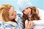 Portrait of mother and her daughter in warm winter clothes Stock Photo - Royalty-Free, Artist: pressmaster                   , Code: 400-05714722